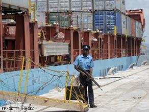 A Kenyan police officer guards the U.S.-flagged Maersk Alabama at a Mombasa port Sunday.