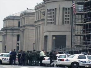 Police cars mass outside the Holocaust Museum in Washington after a shooting there on Wednesday.