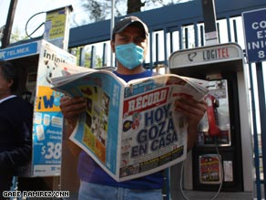 A man wearing a protective mask reads a newspaper outside a hospital in Mexico City.