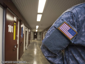 A U.S. miliary guard stands inside the Camp V area at the U.S. Naval Base in Guantanamo Bay, Cuba, in 2006.