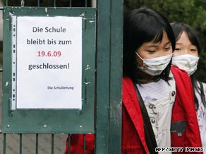 Children leave a Japanese school in Germany which has been closed following a swine flu outbreak.