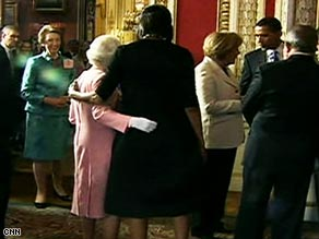 Britain's Queen Elizabeth II and first lady Michelle Obama embrace while meeting Wednesday in London.