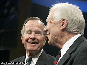Former Presidents George H.W. Bush, left, and Jimmy Carter can smile now about their performance in polls.