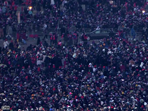Tens of thousands of people had gathered on the National Mall by 7:15 a.m. ET Tuesday.