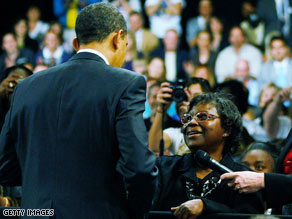 President Obama talks to Henrietta Hughes at a town hall rally in Fort Myers, Florida, on Tuesday.