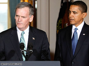 Sen. Judd Gregg, R-New Hampshire, speaks next to President Obama.