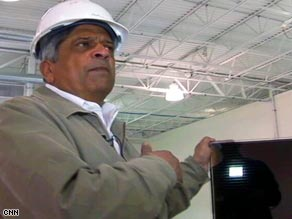 AVA Solar CEO Pascal Noronha holds one of the solar panels his company produces.