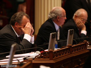 California state senators struggle through a long budget negotiation session Tuesday.