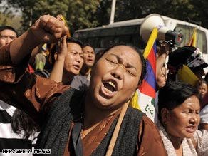 In India on Wednesday, Tibetans living in exile protest Chinese rule in Tibet.