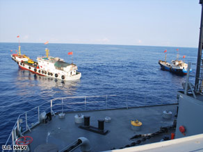 "The Navy says this photo shows two Chinese trawlers forcing the Impeccable to make an emergency ""all stop."""