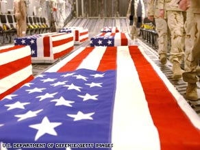 A transport plane carries caskets of U.S. servicemen in this photo the Pentagon released in 2005.