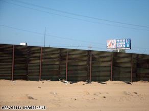 A fence separates the United States from Mexico in the U.S. Border Patrol's Yuma Sector in San Luis, Arizona.