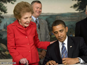 Nancy Reagan watches President Obama sign the Ronald Reagan Centennial Commission Act Tuesday.