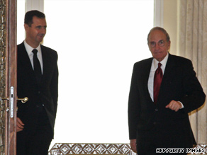 Syrian President Bashar al-Assad, left, welcomes U.S. envoy George Mitchell in Damascus on June 13.