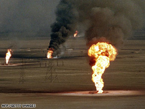 A March 1991 photo shows burning oil wells in Kuwait damaged by Iraq military forces.