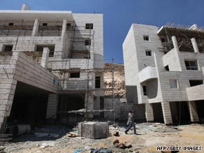 Laborers work on a construction site of new housing units in an Israeli settlement north of Jerusalem.