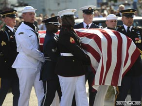 The coffin of Senator Edward Kennedy is carried by an honor guard.
