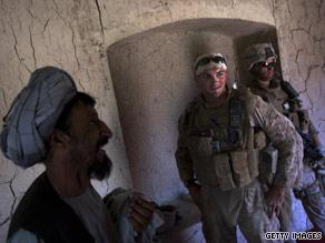 Marines speak to Afghan villagers in southern Afghanistan, on September 28.