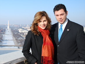 Rep. Jason Chaffetz and his wife Julie pose in front of a view of Washington.