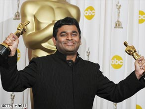Feeling like a millionaire: AR Rahman picked up two Oscars for best original song and best score.