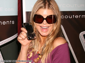 Singer Fergie shows off a product she received at the BET Awards Lounge in 2008.