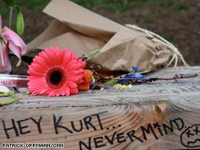Fans leave flowers and mementos in honor of Kurt Cobain near his Seattle home.