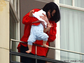 Michael Jackson introduces Prince Michael II, in 2002, to fans gathered four stories below in Berlin, Germany.