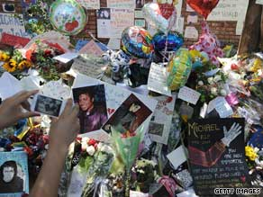 Fans have set up impromptu shrines to Michael Jackson, including this one at his family's house.
