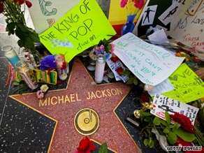 Michael Jackson's star on the Hollywood Walk of Fame is surrounded by items from fans.