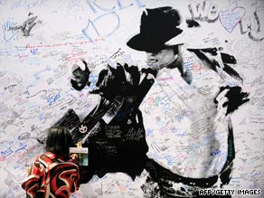 A memorial poster for Michael Jackson is displayed outside Staples Center in Los Angeles on Sunday.