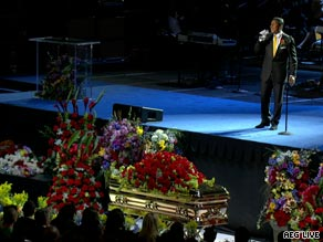 "Jermaine Jackson sings his brother's favorite song ""Smile"" in front of the King of Pop's casket."