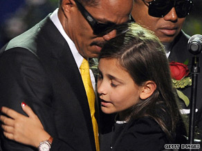 Paris Jackson, 11, is consoled by her uncle Marlon Jackson after delivering a tearful tribute to her father.