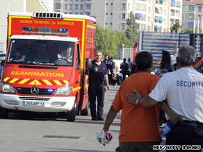 Firefighters leave the Stade Velodrome stadium in Marseille after the accident on Thursday.