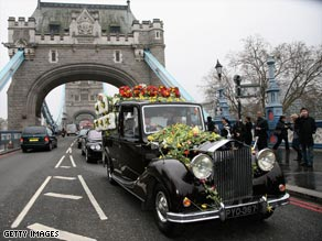 The funeral cortege of Jade Goody crosses London's Tower Bridge Saturday.