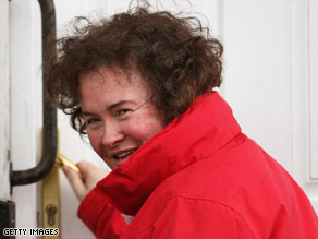 Overnight sensation Susan Boyle enters her home in West Lothian, Scotland, on May 8.