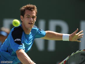 Murray plays a backhand volley during his three-set win over Federer.