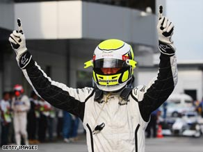 Button raises his arms in triumph after claiming pole for the second straight week.