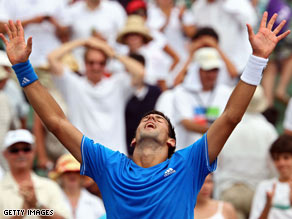 Novak Djokovic reacts Friday after defeating Roger Federer in Key Biscayne, Florida.