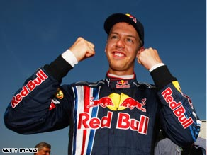 Vettel celebrates the first of what many predict will be many pole positions.