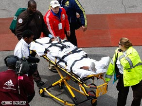 Ethiopia's 2008 winner Dire Tune is stretchered away after losing her Boston Marathon title on the line.