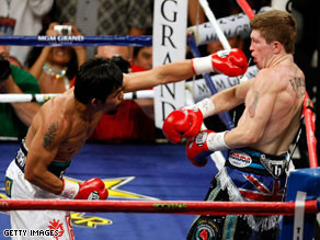 Pacquiao throws a left to Hatton in the brief fight.