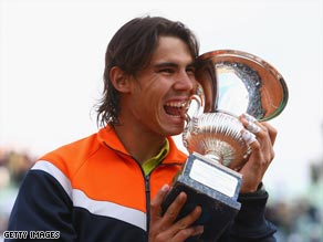 Rafael Nadal in familiar pose after winning the Rome Masters for his fifth tournament victory of the season.