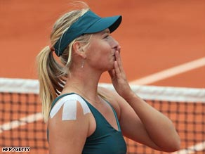 Sealed with a kiss. Sharapova celebrates her victory over Petrova.