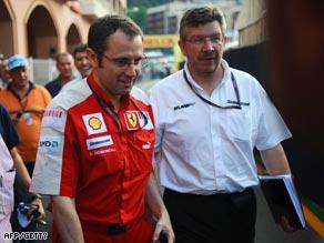 Ferrari's team manager Luca Baldisseri (L) and Brawn GP's team principal Ross Brawn leave the meeting in Monaco.