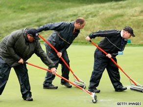 Bethpage Black green keepers attempt to get water off the course as heavy rain engulfs the U.S. Open.