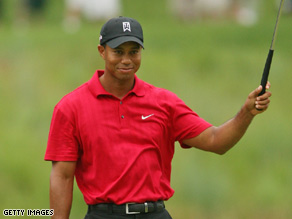 Tiger Woods waves to the crowd on Sunday on the 18th hole at the AT&T National.