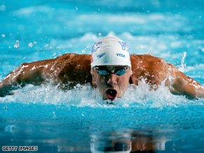 Michael Phelps attacks the pool in Indianapolis to set a new world mark in the 100m fly.