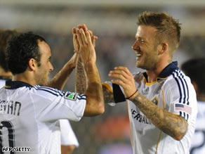 Beckham and Donovan (left) share the moment after the England star's goal.