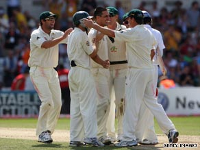 Mitchell Johnson is surrounded by his Australian team-mates after taking the wicket that won the fourth Test.