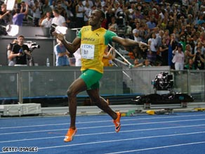 Bolt crosses the line in the 200m final in a world record 19.19 seconds.